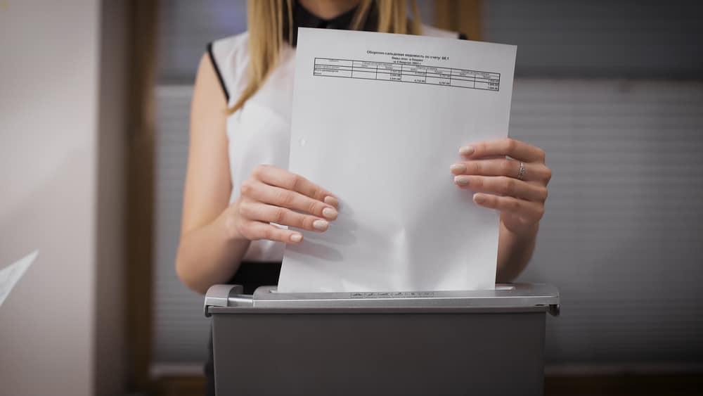Woman Shredding Paper